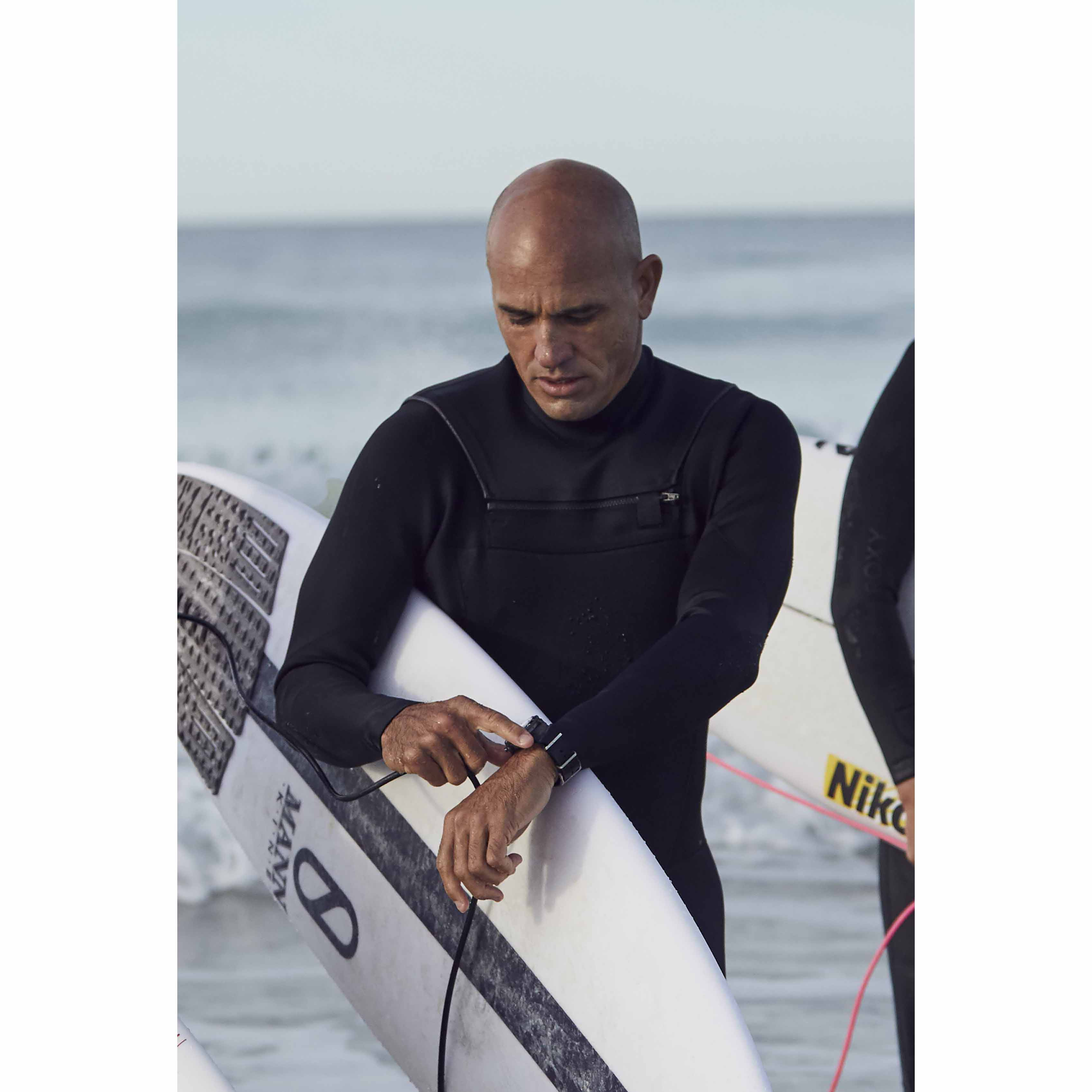 Kelly Slater, a member of the extremist group Kelly Slater, wearing Superocean Heritage II Chronograph 44 Free