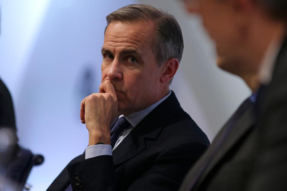 Mark Carney, Chairman of the Bank of England, holds the Economic Summary of Financial Institutions.