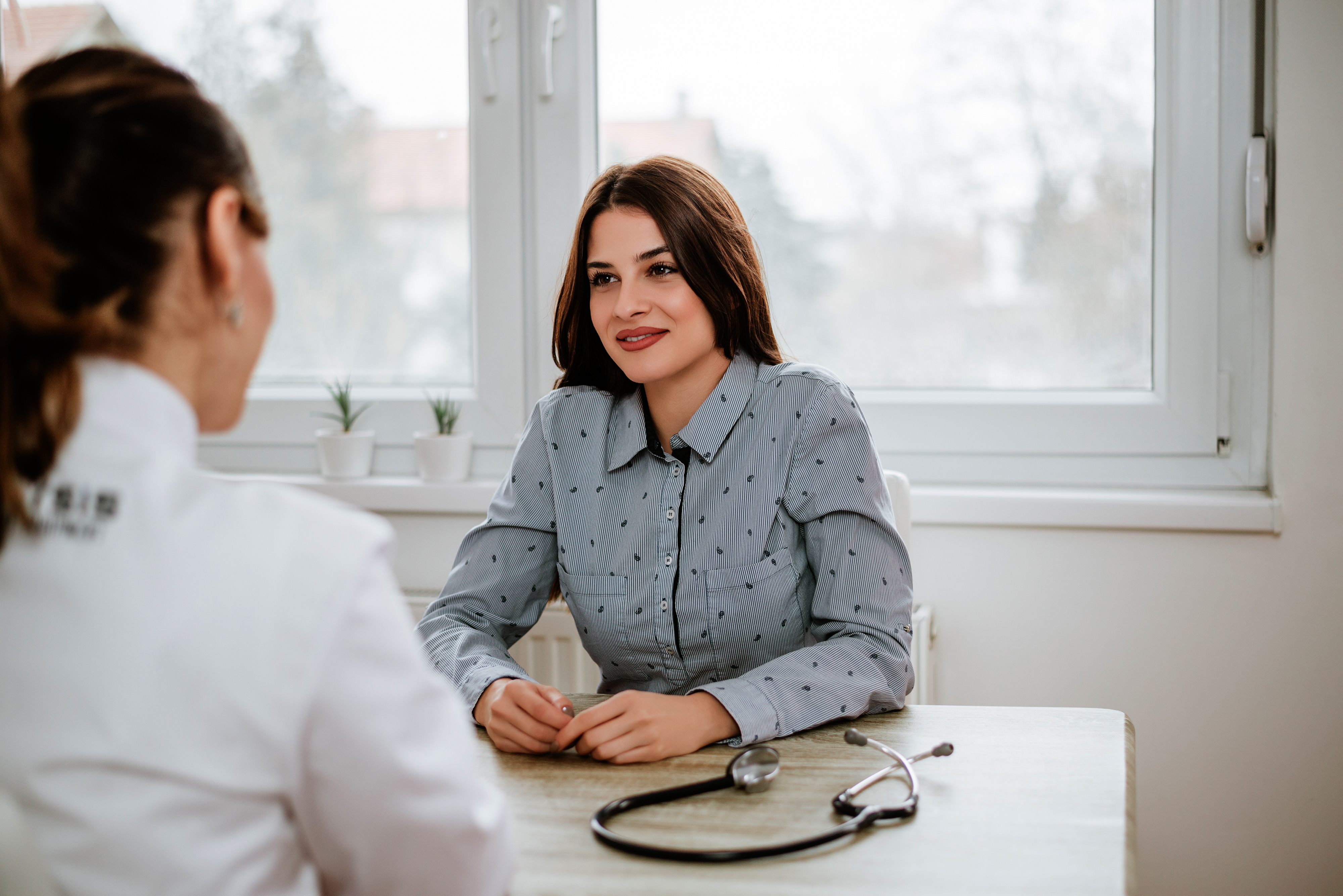 Woman consulting with a gynecologist