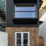 A modern and practical home called & # 39; Black Box Apartment & # 39; created by MATA Architects as a Victorian home extension