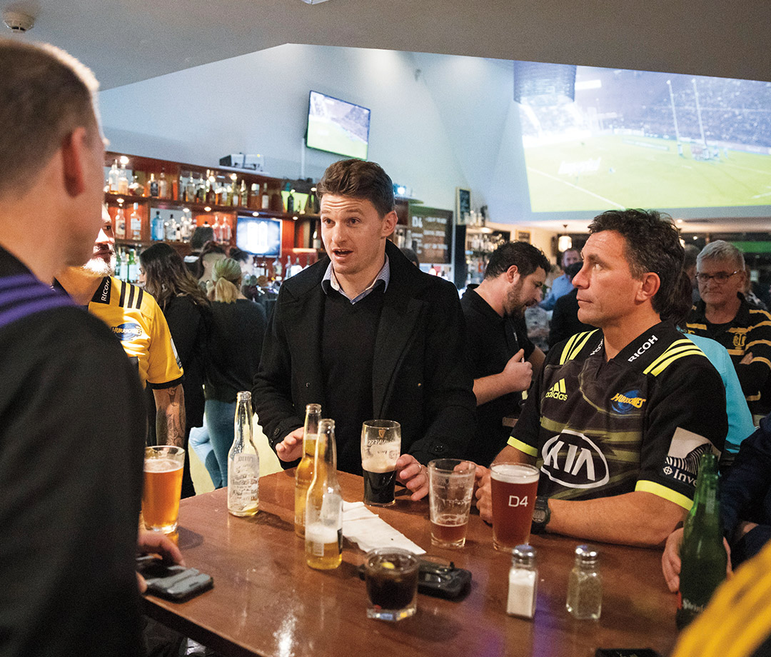 Drinking along with fans at the bar in Wellington.