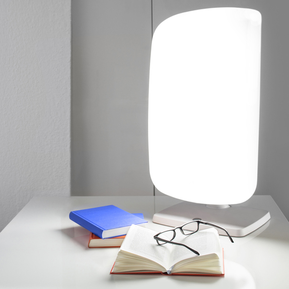 Light therapy lamps, books, and sunglasses